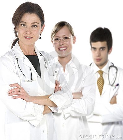 Friendly young doctors smiling over a white backgr