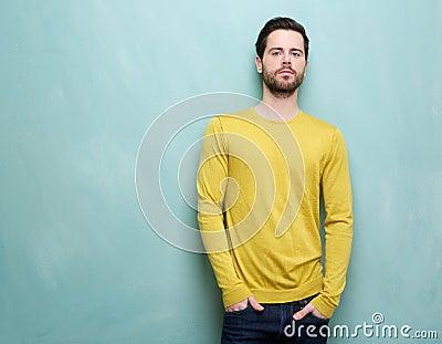 Friendly young man posing in yellow shirt