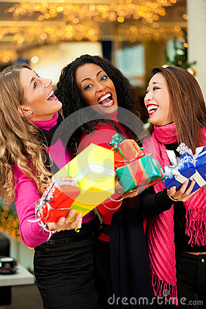 Free Friends Christmas Shopping With Presents In Mall Royalty Free Stock Photo - 27039225