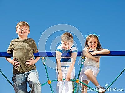 Friends climbing the net