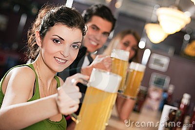 Friends drinking beer in bar