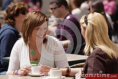 Friends drinking coffee outside