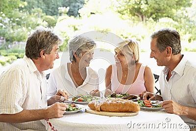 Friends Eating An Al Fresco Lunch