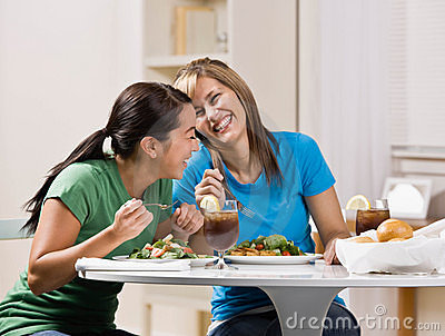 Friends eating healthy lunch and laughing