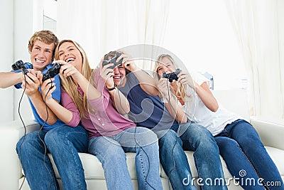 Friends enjoying video games