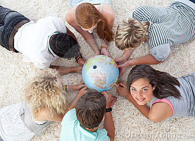 Friends on the floor examining a terrestrial world