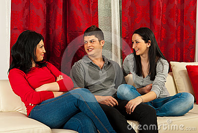 Friends having conversation on sofa
