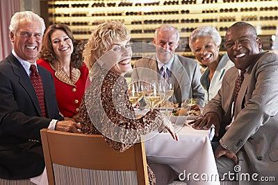 Friends Having Dinner At A Restaurant
