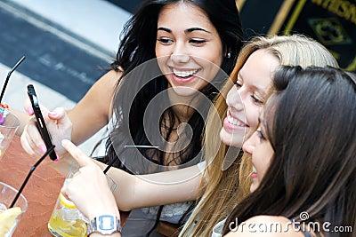 Friends having fun with smartphones