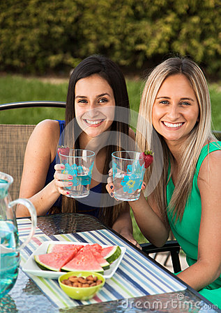 Free Friends Having Lunch At A Cafe Laughing And Smiling Stock Photo - 31014170