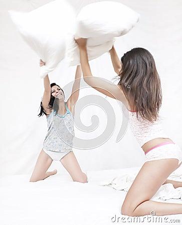 Friends having a pillow fight