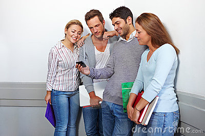 Friends looking at smartphone