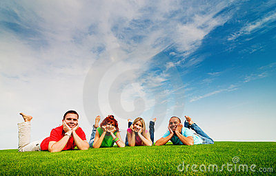 Friends lying on grass