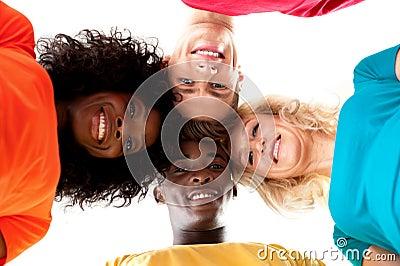 Friends making circle and looking down at camera