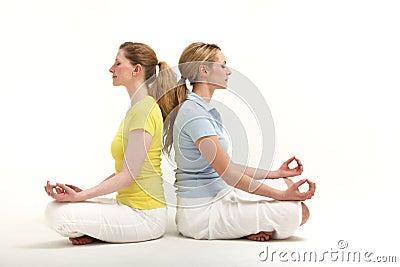 Friends meditating together
