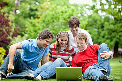 Friends outdoors with laptop
