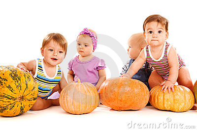 Friends playing with pumpkins