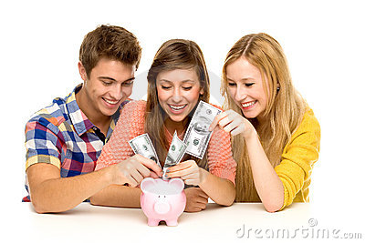 Friends putting money in piggy bank