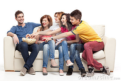 Friends reaching for the popcorn