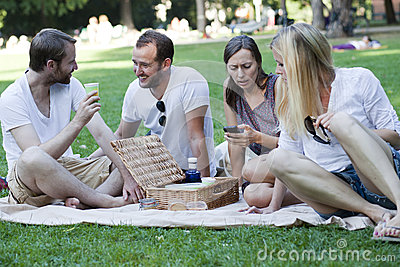 Friends relaxing in park