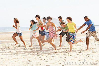 Friends Running Along Beach Together