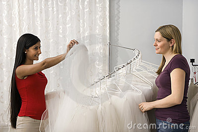 Friends shopping for veils.
