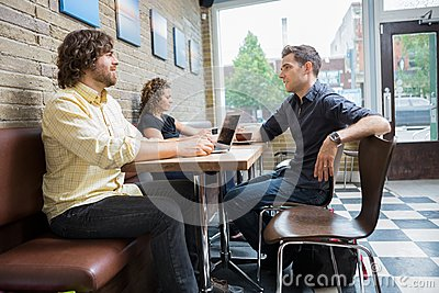 Friends Spending Leisure Time In Cafe