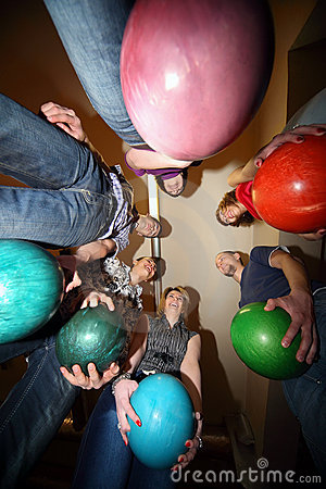 Friends stand in circle and everybody hold ball