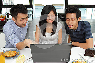 Friends using a laptop