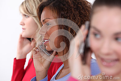 Friends using mobile telephones