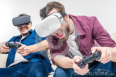 Friends in virtual reality headsets Stock Photo
