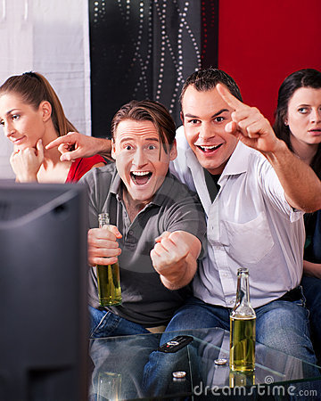 Free Friends Watching Exciting Game At TV Stock Photos - 15519763