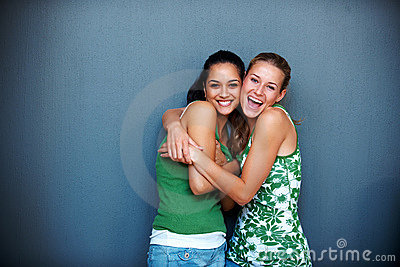 Friendship - Two girlfriends hugging eachother