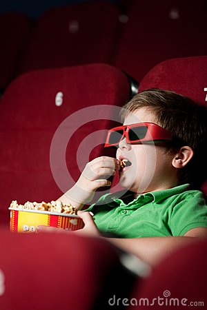 Frightened boy in 3D movie