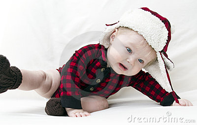 Frightened Christmas baby falling over
