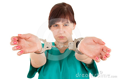 Frightened  lady doctor with handcuffed hands