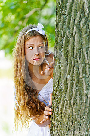 Frightened teenage peeping from