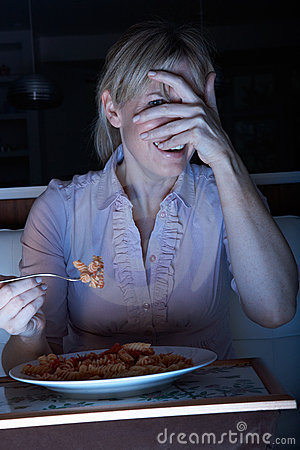 Frightened Woman Enjoying Meal Watching TV