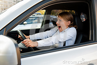 Frightened woman sitting in the car