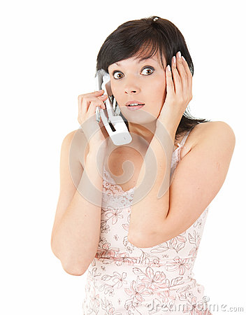 Frightened young woman on the phone