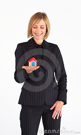 Frinedly mature businesswoman holding a house