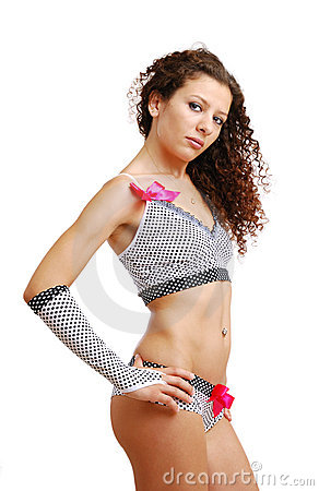Frizzy girl in polka dot erotic clothes with bows
