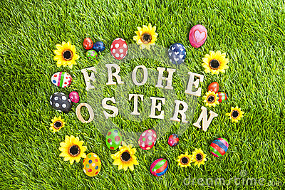 Frohe ostern eggs on grass