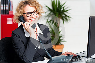 Front desk lady attending clients call