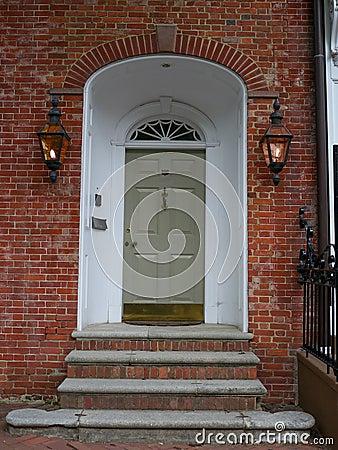 Front door on brick wall