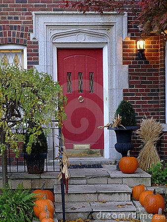 Front door with pumpkins