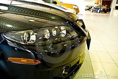 Front end of cars in showroom