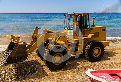 Front End Loader On Seashore