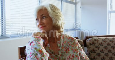 Front view of active Caucasian senior woman relaxing at nursing home 4k. Front view of active Caucasian senior woman relaxing at nursing home. She is looking stock footage