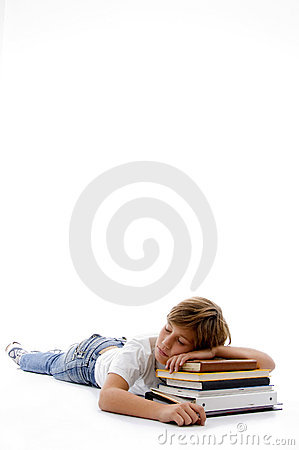 Front view of boy sleeping on books